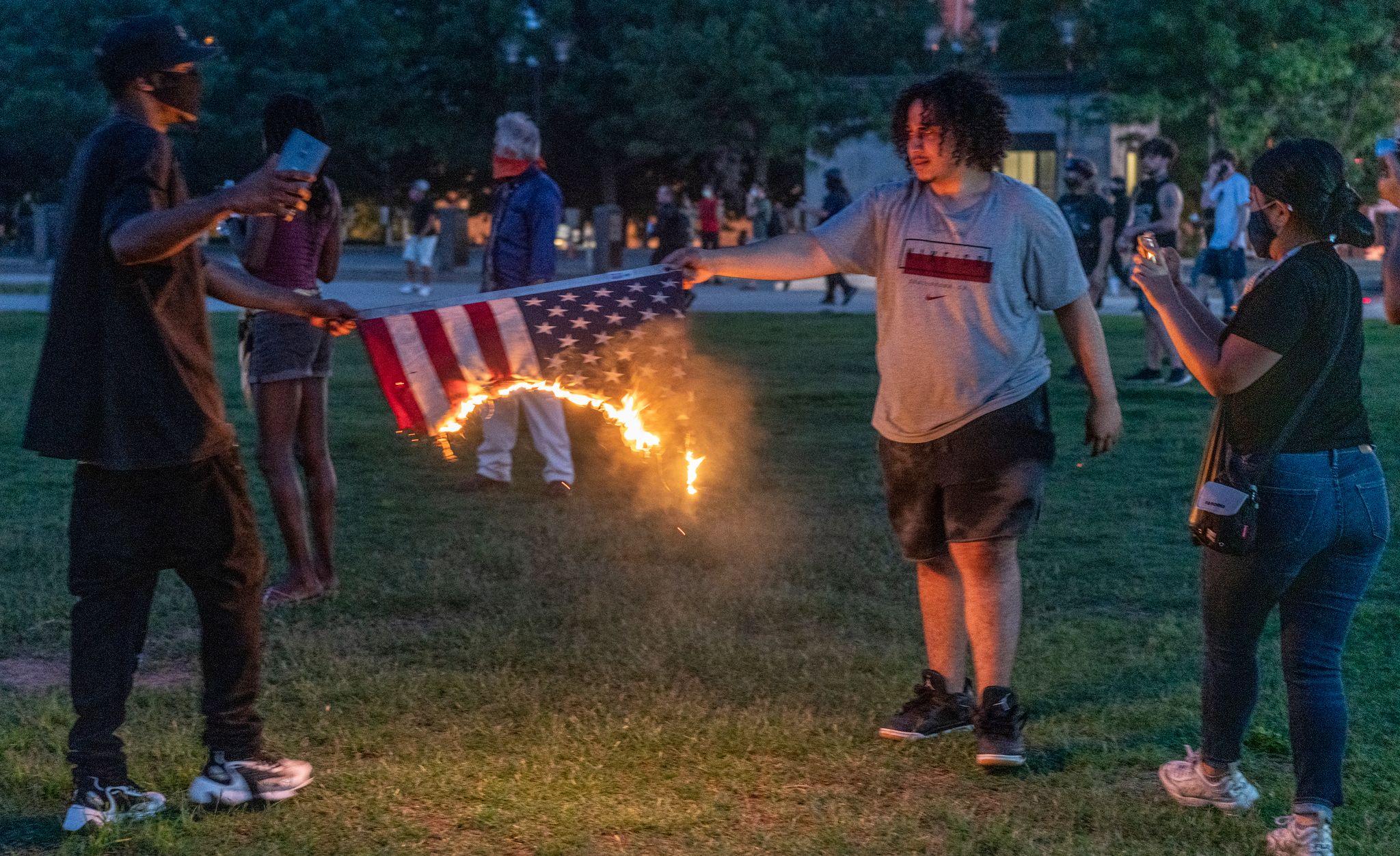 Nashville, Tenn., May 30 - The American flag on fire. (Photo: John Partipilo)