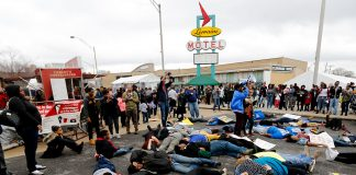 "Supporters of the Black Lives Matter movement stage a ""die in"" outside the National Civil Rights Museum following the annual Martin Luther King Day march on January 16, 2017 in Memphis, Tennessee. Hundreds marched from the north end of downtown Memphis in honor of the civil rights leader to the site where King was assassinated in 1968, which now houses the National Civil Rights Museum. (Photo by Mike Brown/Getty Images)"
