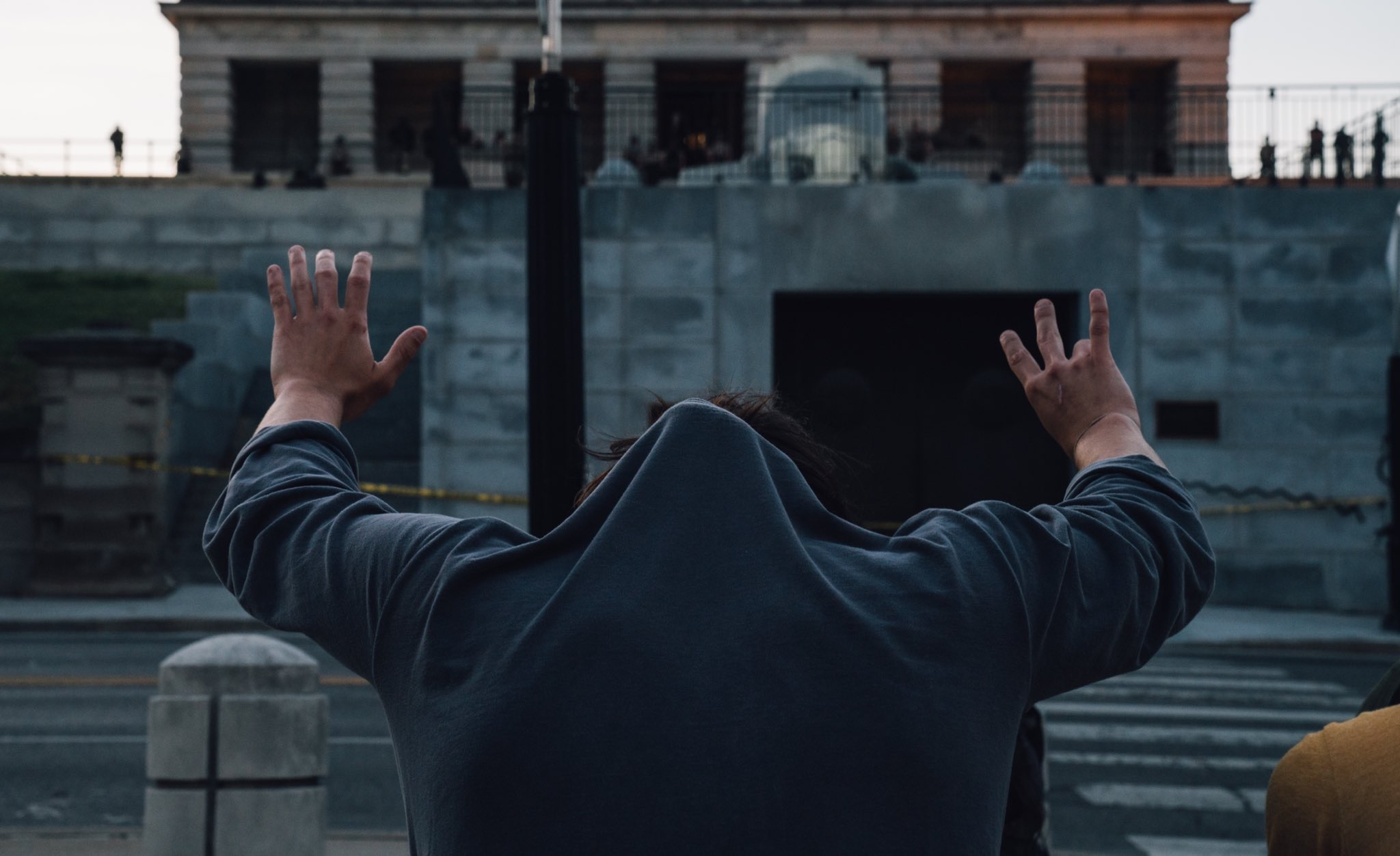 Nashville, Tenn., May 31 - A demonstrator kneels in front of the capitol and holds up eight fingers to signify the amount of time Minneapolis police officer Derek Chauvin kneeled on George Floyd's neck. (Photo: Alex Kent)