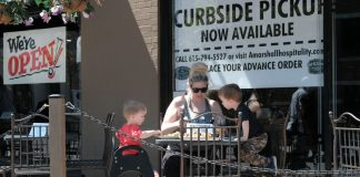Family eats outside at restuarant in