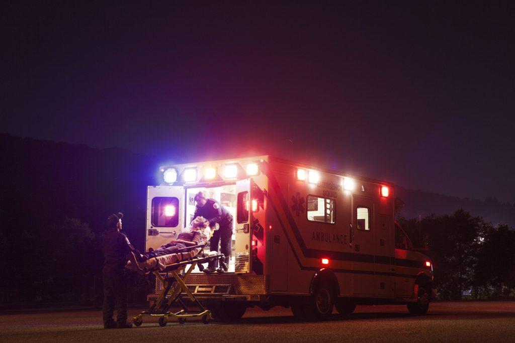 An ambulance picks up a sick patient, (Cavan/Getty Images)