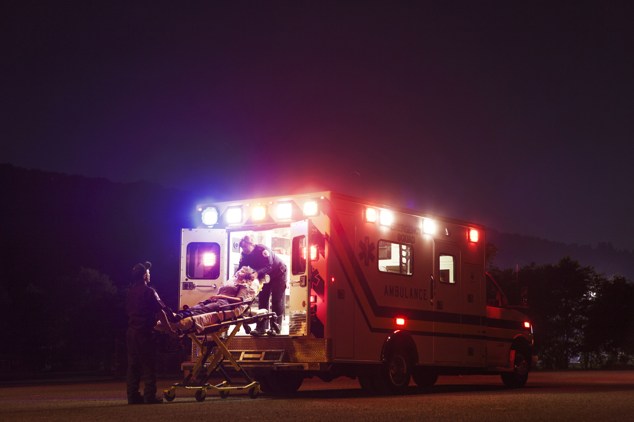 An ambulance picks up a sick patient, (Cavan/Getty Images)
