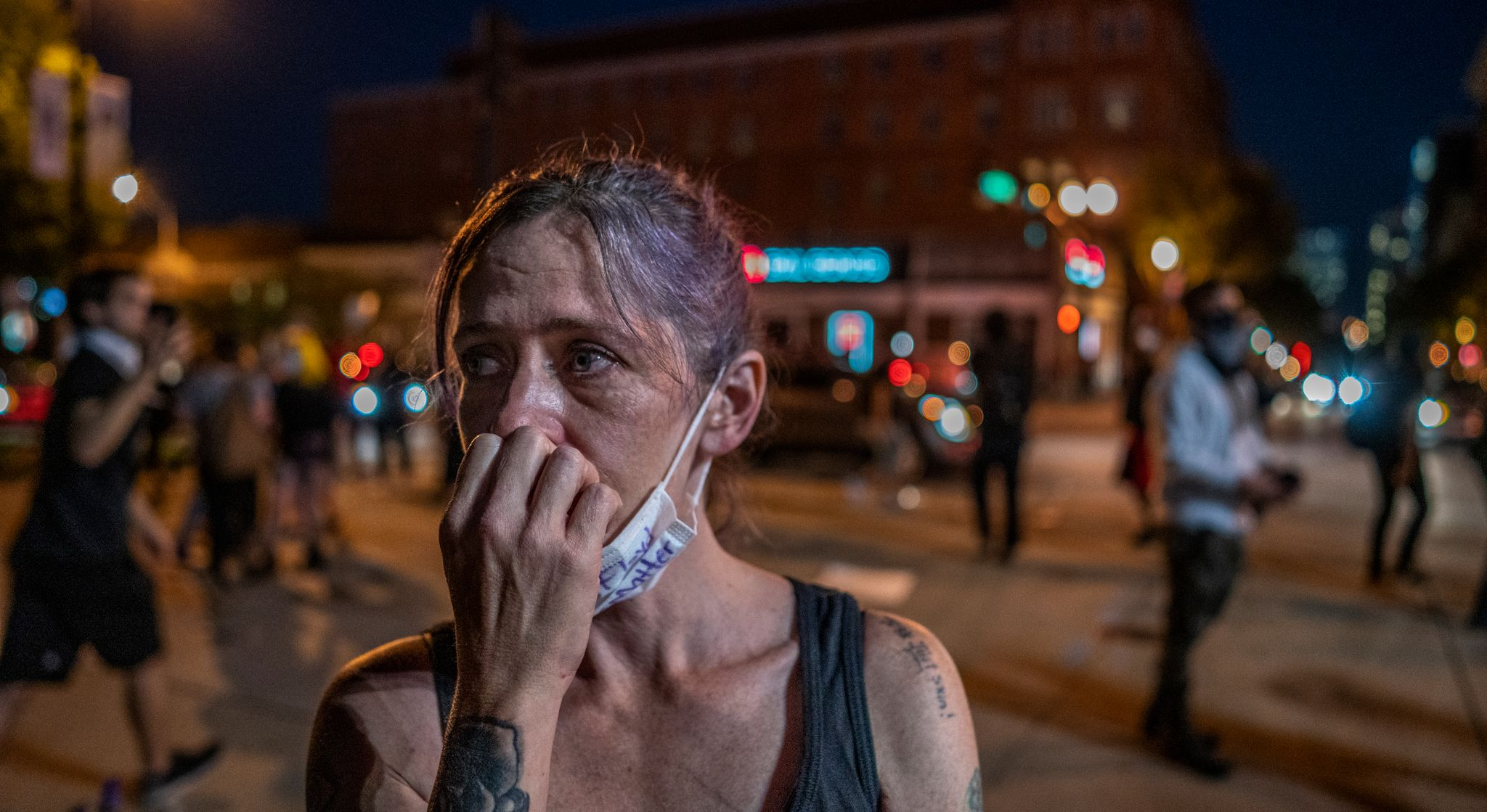 Nashville, Tenn., May 30 - A woman clutches her face in the aftermath of riots in downtown Nashville Saturday. (Photo: John Partipilo)