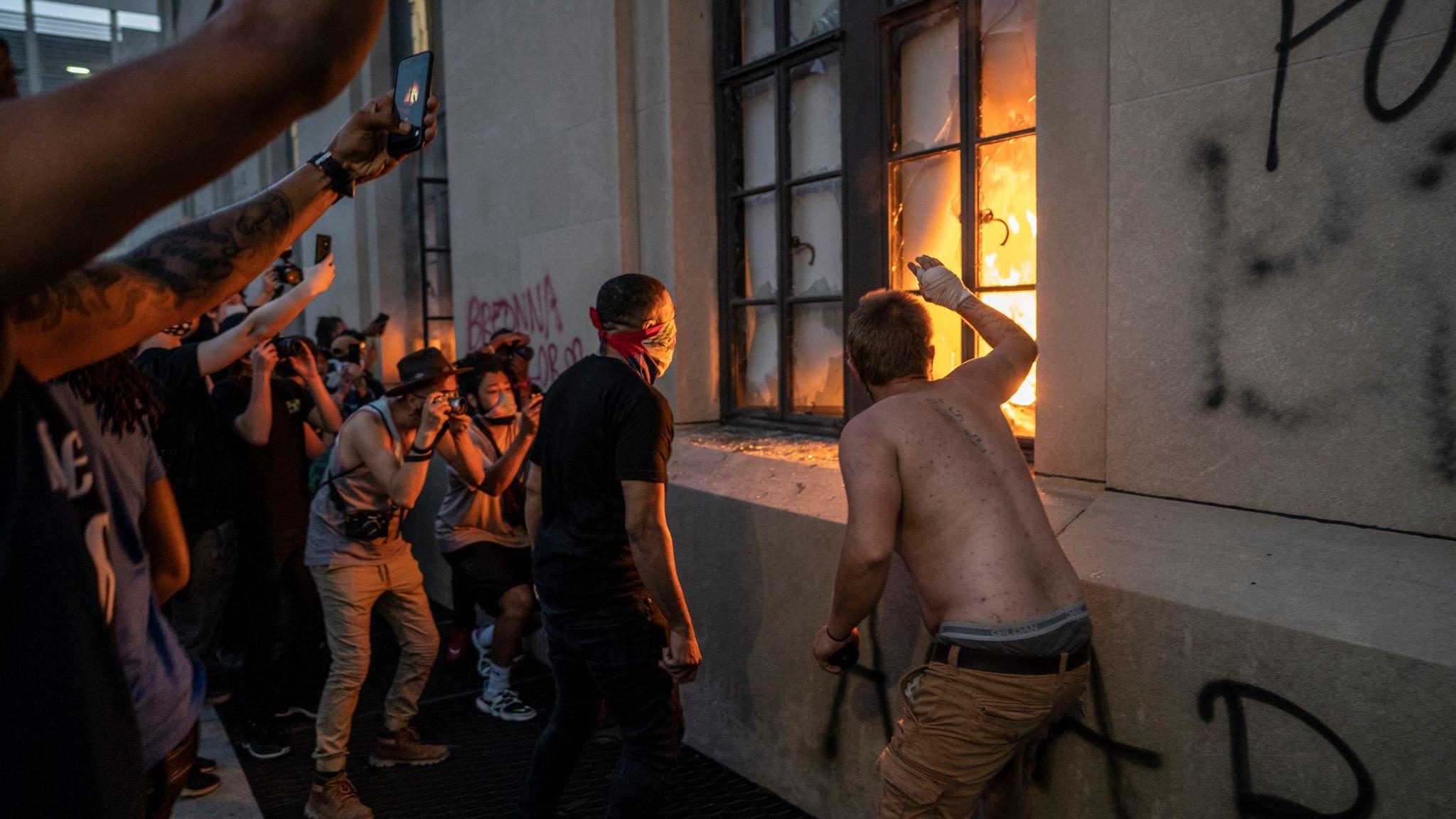 Nashville, Tenn. - A crowd outside Historic Metro Nashville Courthouse looks at fires inside the building. (Photo: John Partipilo)