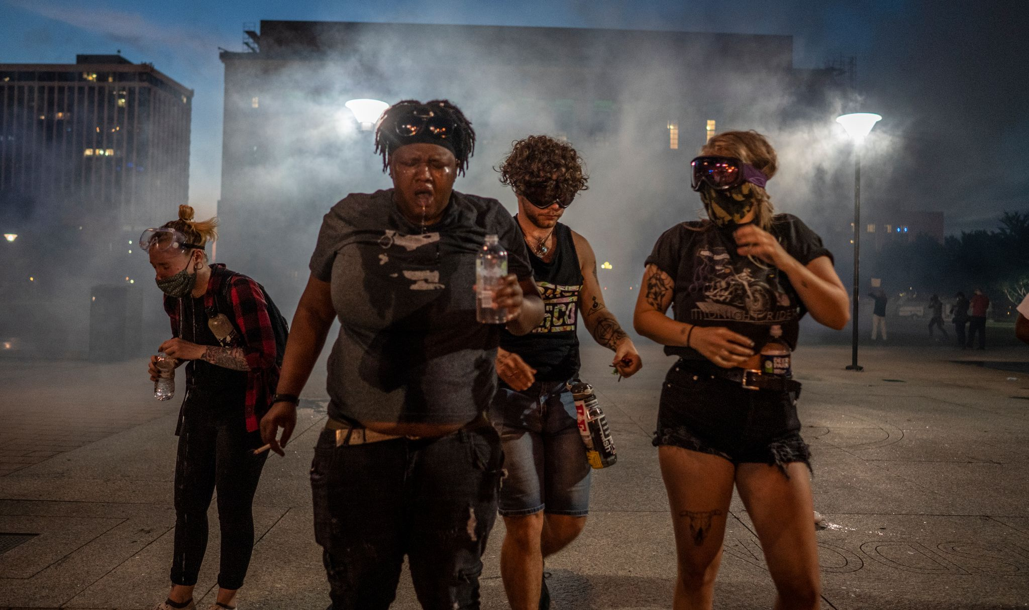 Nashville, Tenn., May 30 - A group of women walk away from the Nashville courthouse after being in a crowd of protestors on whom tear gas was used. (Photo: John Partipilo)