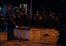 Nashville, Tenn., May 30 -The Thin Blue Line. Metro Police in riot gear line up outside the parking garage at Nashville City Hall. (Photo: Alex Kent)