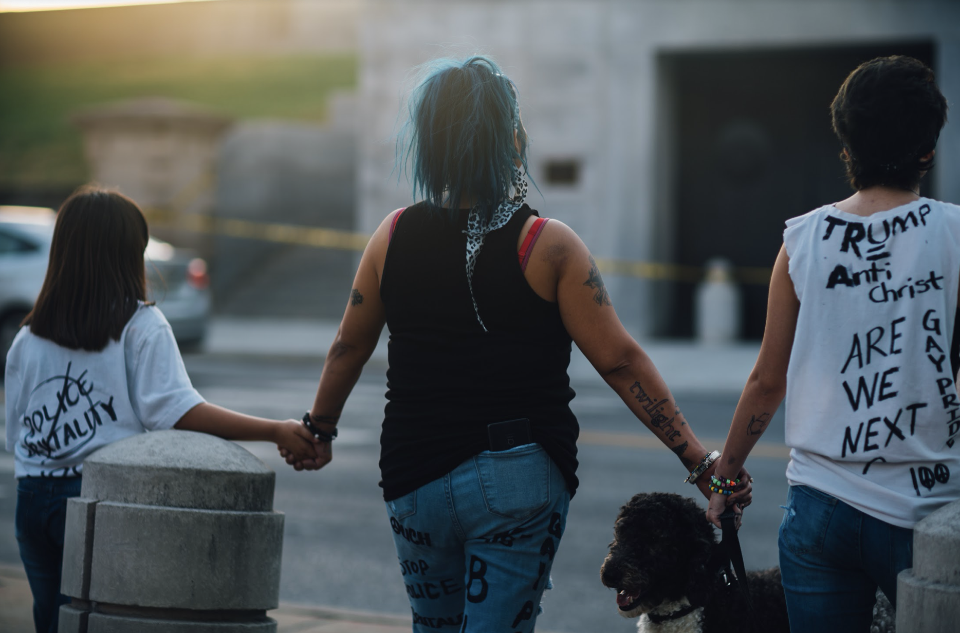 Nashville, Tenn., May 31- Three women hold hands in a peaceful Sunday protest at the Tennessee Capitol. (Photo: Alex Kent)