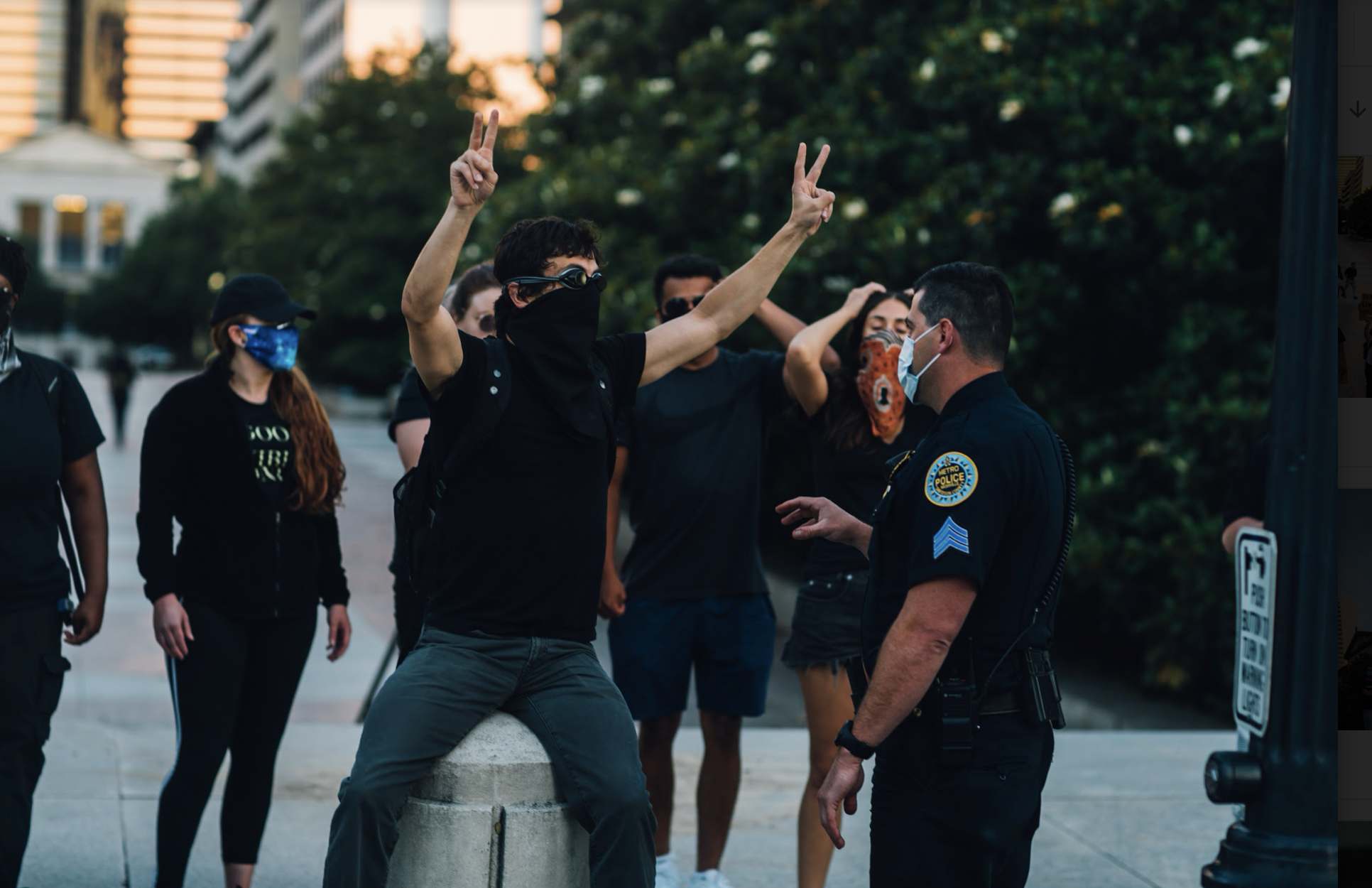 Nashville, Tenn. May 31 - A demonstrator gesticulates with eight fingers, to symbolize how long George Floyd was held down, at a Metro Nashville Police officer. j(Photo: Alex Kent)