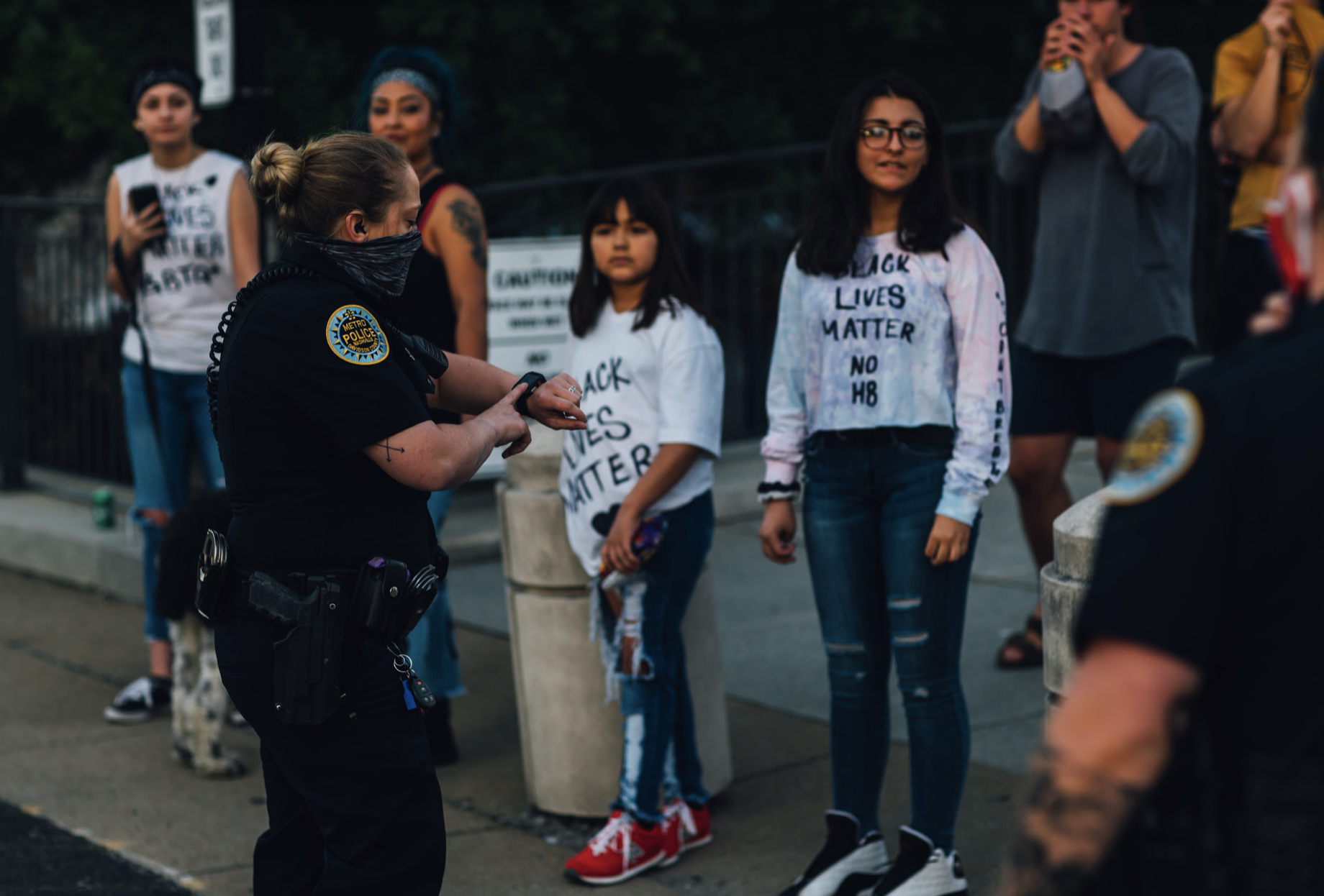 Nashville, Tenn., May 31 - A Metro police officer tells protestors 8 p.m. curfew has passed. (Photo: Alex Kent)