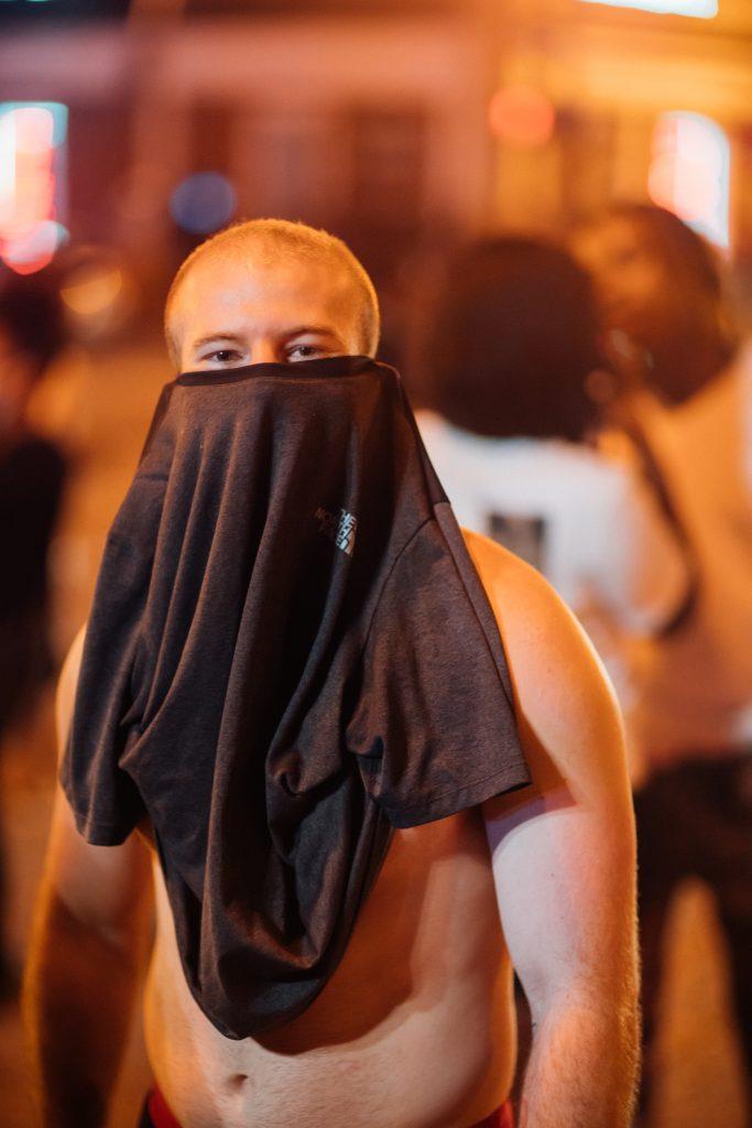 Nashville, Tenn., May 30- Nashville, Tenn., May 30- A man uses his t-shirt as a makeshift face mask during protests. (Photo: Alex Kent)