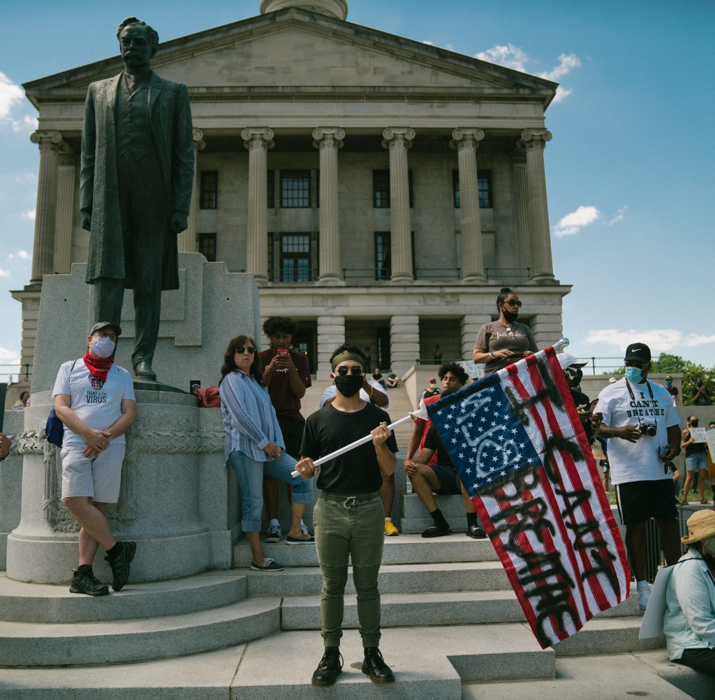 Nashville, Tenn., May 30 - Protesters stand in front of the Tennessee State Capitol and the statue of former U.S. Sen. Edward Carmack. Members of the crowd tore the Carmack statue down later in the day. (Photo: Alex Kent)