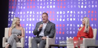 Conservative radio host Elisha Krauss, Knox County Mayor Glenn Jacobs and conservative commentator Tomi Lahren at 2019 Politicon in Nashville(Photo by Jason Kempin/Getty Images for Politicon )