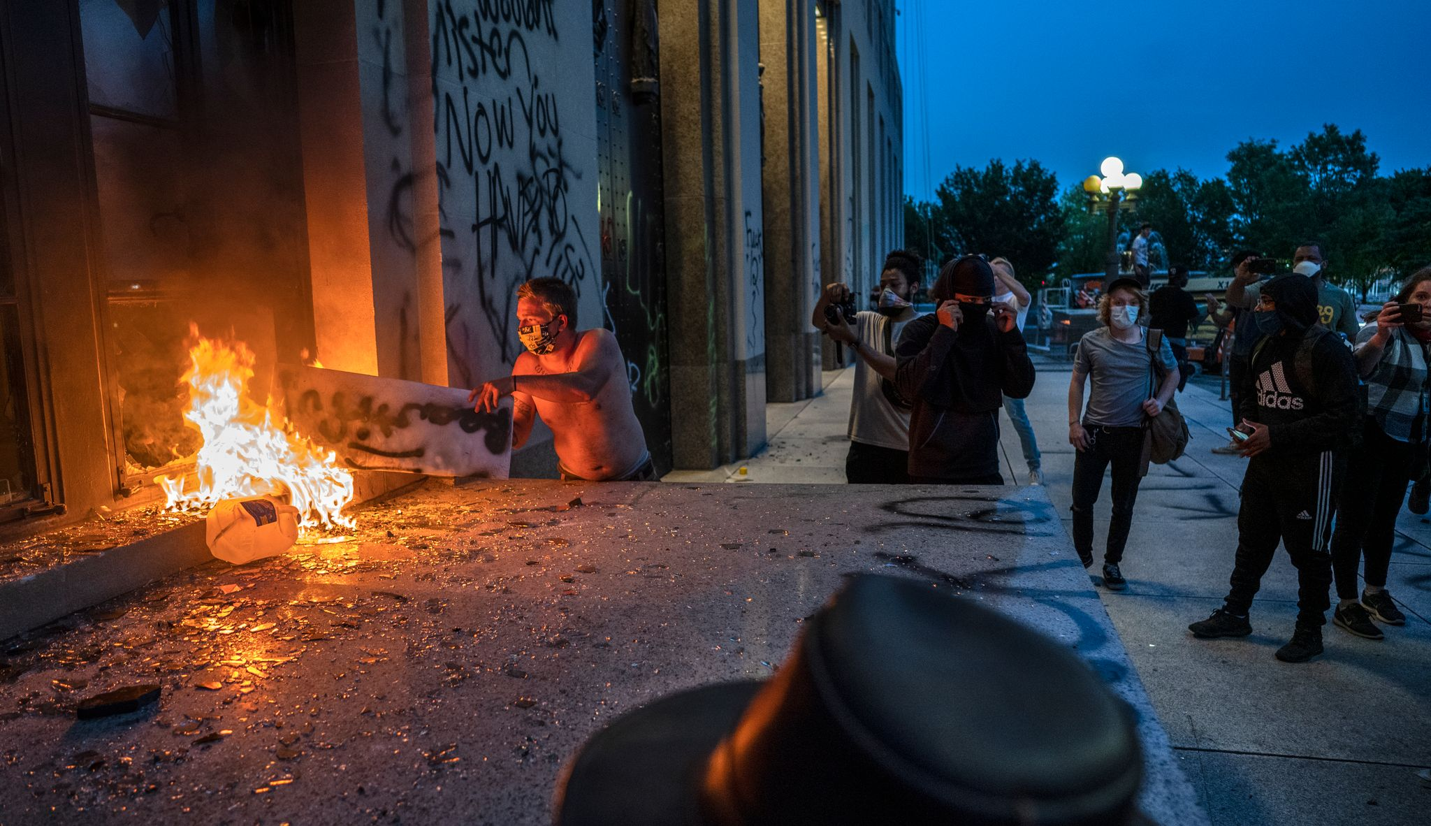 Nashville, Tenn., May 30 - A protestor sets fire to Historic Metro Nashville Courthouse while bystanders ignore him. (Photo: John Partipilo)
