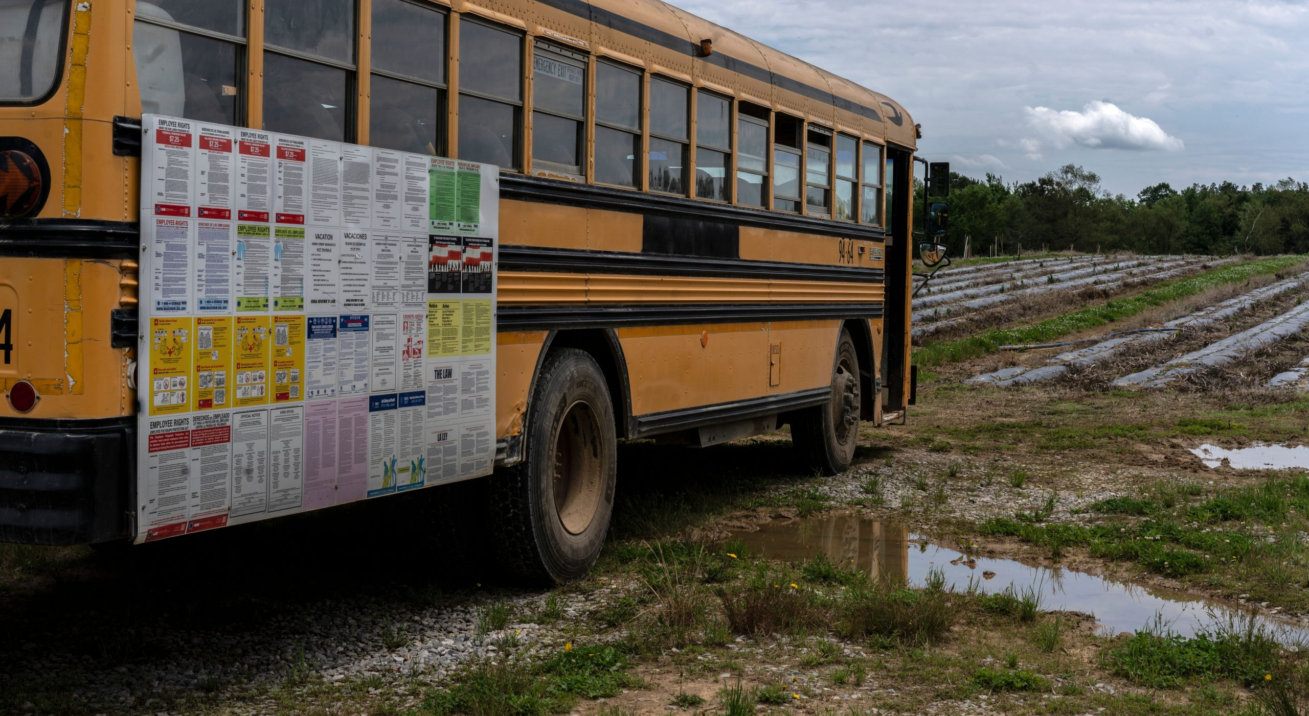 School bus presumably used to transport workers to and from fields. (Photo: John Partipilo)