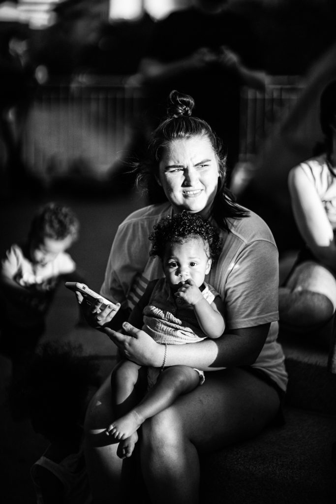 Nashville, Tenn., Jume 12 - A woman holds her child at the Capitol Hill Autonomous Zone. (Photo: Alex Kent)