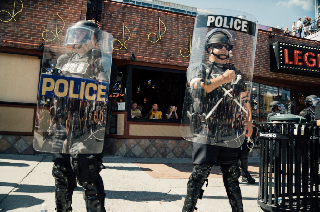 Metro Nashville Police in riot gear stand on Lower Broadway during a recent Black Lives Matter protest. (Photo: Alex Kent)
