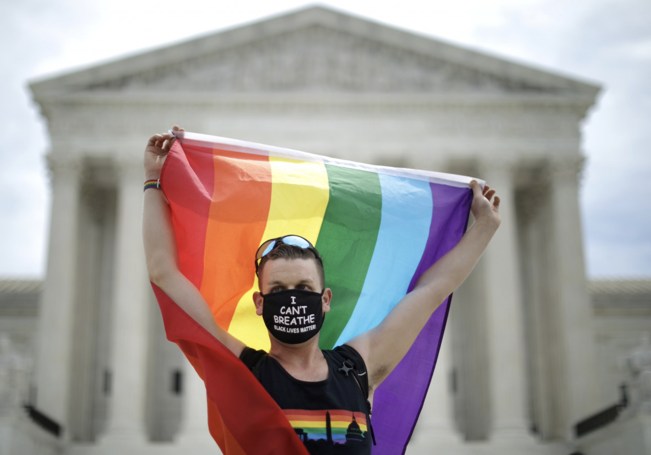Joseph Fons holding a Pride Flag, stands in front of the U.S. Supreme Court building after the court ruled that LGBTQ people can not be disciplined or fired based on their sexual orientation June 15, 2020. (Photo: Chip Somodevilla/Getty Images)