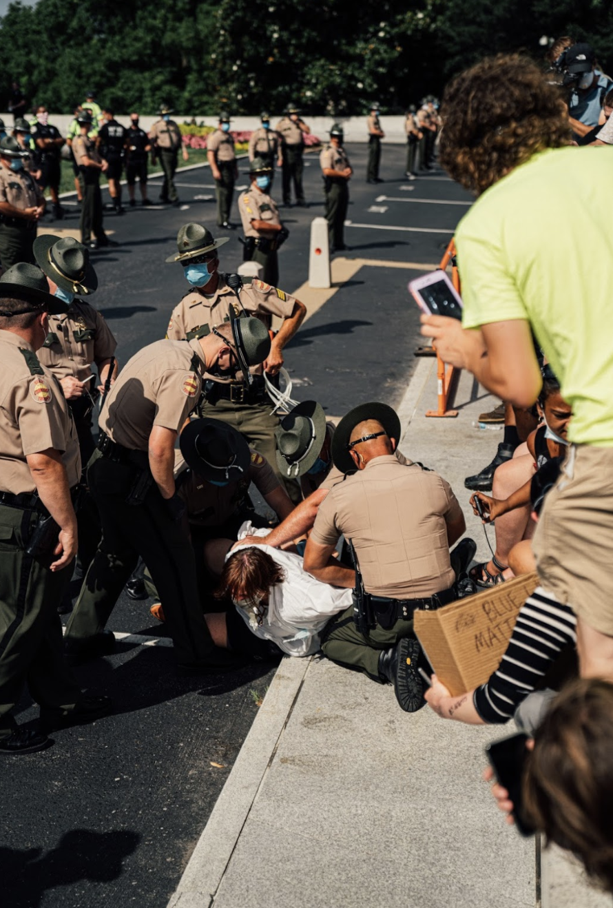 Nashville, Tenn., June 28 - Tennessee state troopers arrest a Black Lives Matter protester in front of the State Capitol. (Photo: Alex Kent)