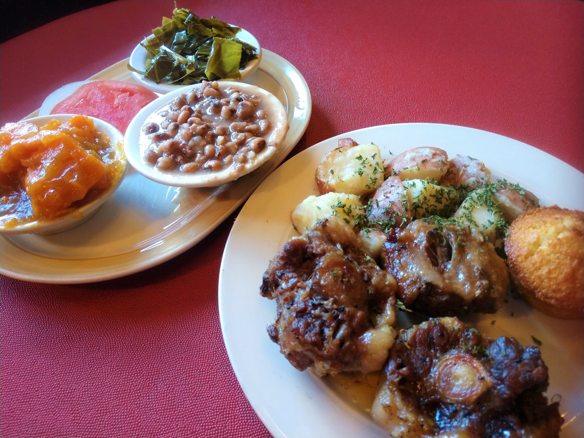 The menu at Herman's in Chattanooga features oxtail, collards, crowder peas, yams and more every Wednesday. (Photo: Anne Braly)