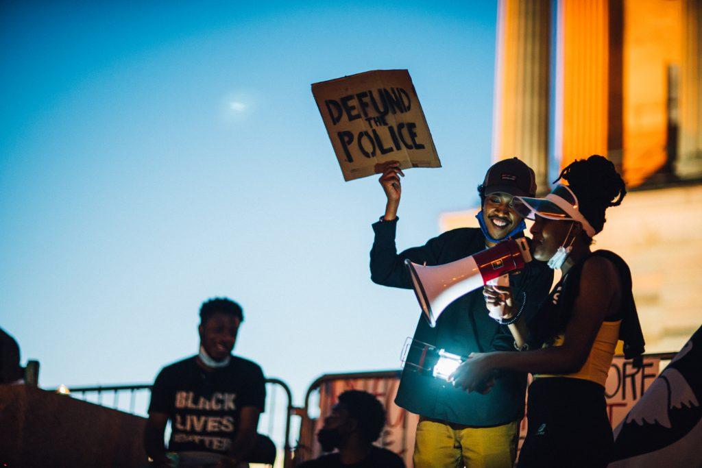 Nashville, Tenn., June 12- Activist Justin Jones, a leader of the Capitol Hill Autonomous Zone, confers with a fellow activist at the CHAZ. (Photo: Alex Kent)