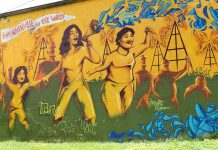 A mural on the wall outside Workers' Dignity's community center. (Photo: Dulce Torres Guzman/Tennessee Lookout)
