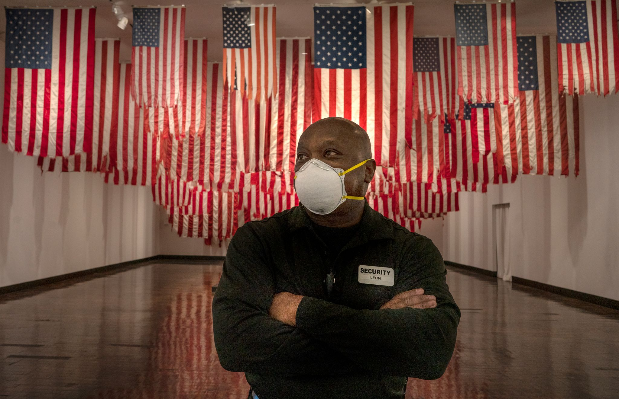 """In July 2020, a masked security guard stands watch inside the Frist Museum in the series, """"The New Normal."""" (Photo: John Partipilo)"""