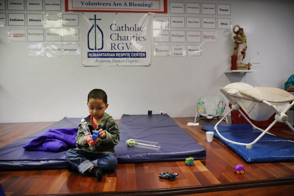 A Honduran child plays at the Catholic Charities Humanitarian Respite Center after recently crossing the U.S., Mexico border with his father on June 21, 2018 in McAllen, Texas. | Spencer Platt/Getty Images
