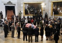 Members of the Congressional Black Caucus say farewell at the conclusion of Monday's memorial ceremony for the late Atlanta Rep. John Lewis in the Capitol Rotunda. Lewis, a civil rights icon and fierce advocate of voting rights for African Americans, died July 17. | J. Scott Applewhite – Pool/Getty Images