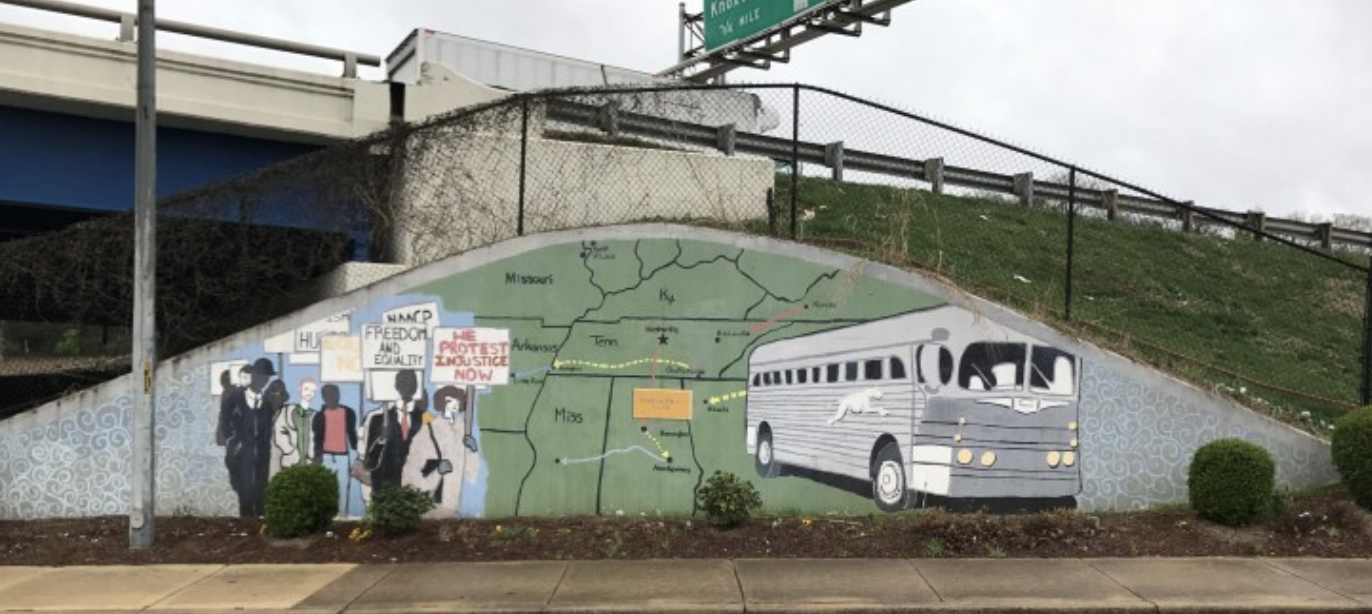 A mural of Freedom Riders painted by artist Michael Cooper on Jefferson Street, just under I-40. (Photo: Theron Corse/NashvillePublicArt.com)