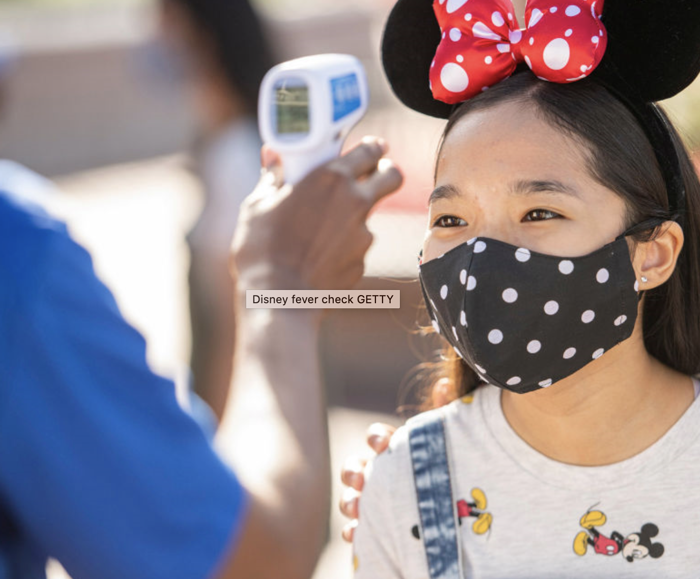 A child is checked for fever at Walt Disney World. Credit: David Roark/Walt Disney World Resort/Getty Images
