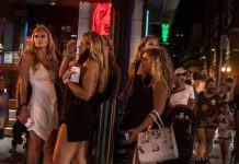 A group of bachelorettes gather outside bars on Nashville's Lower Broadway.
