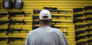 A customer at ABQ Guns in Albuquerque. Recent mass shootings have reignited the debate over gun legislation, including red flag laws and expanded background checks. (Photo by Sergio Flores/Bloomberg, Getty Images)