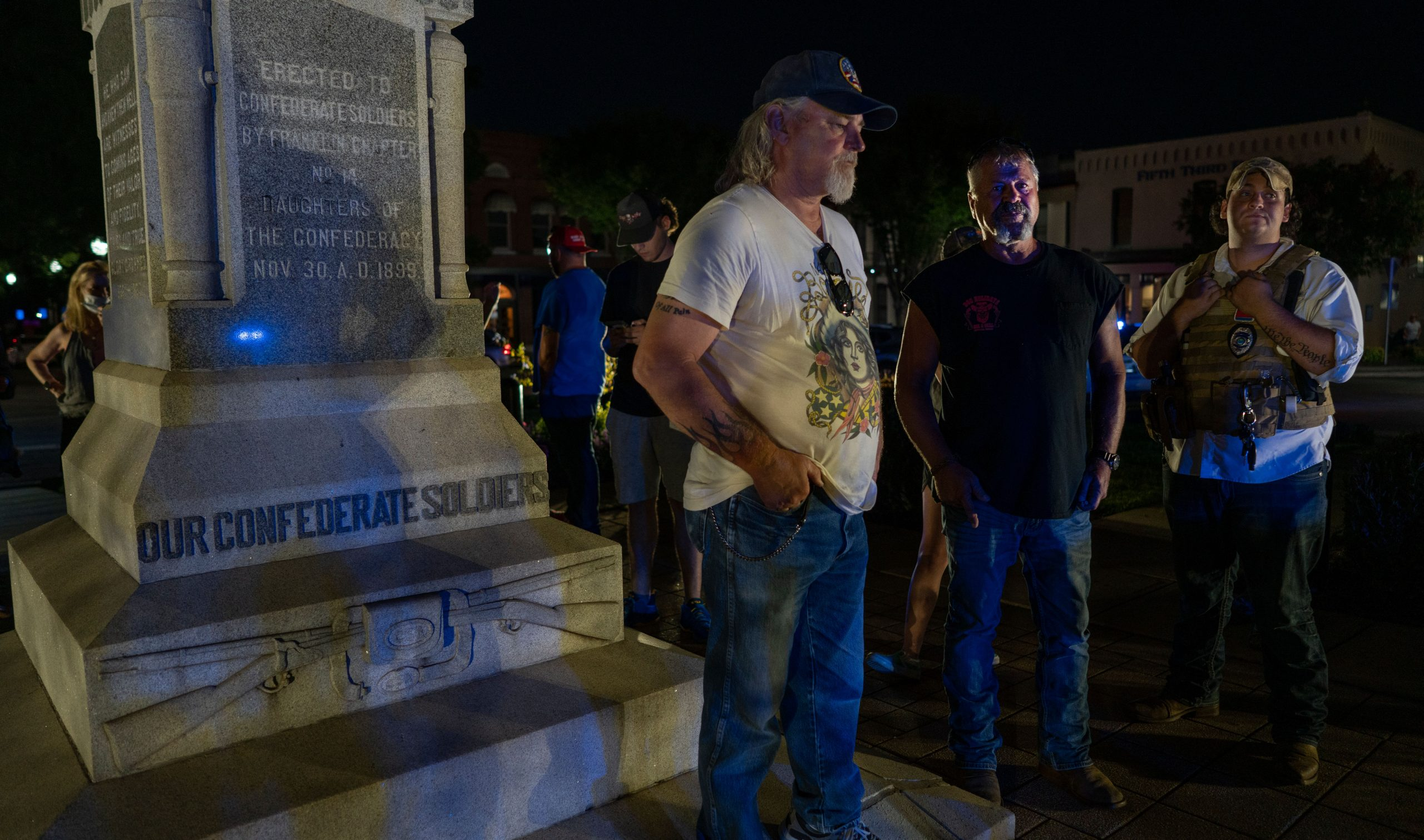 A counter protester stands beside the Confederate statue. (Photo: John Partipilo)