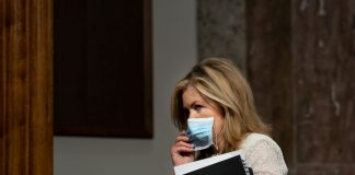 "WASHINGTON, DC - AUGUST 05: Sen. Marsha Blackburn (R-TN) holds a mask to her face as she arrives for a Senate Judiciary Committee hearing on ""Oversight of the Crossfire Hurricane Investigation"" on Capitol Hill on August 5, 2020 in Washington, DC. Crossfire Hurricane was an FBI counterintelligence investigation relating to contacts between Russian officials and associates of Donald Trump. (Photo by Erin Schaff-Pool/Getty Images)"