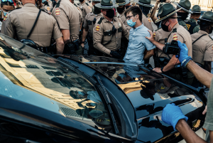 20-year old Caleb King of Clarksville is handcuffed by Tennessee Highway Patrol Officers. (Photo: Alex Kent)