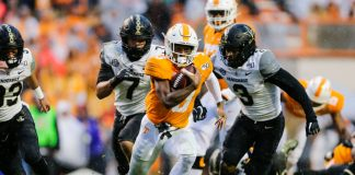 SEC shootout: Eric Gray of the Tennessee Volunteers runs with the ball to score a touchdown against the Vanderbilt Commodores at Neyland Stadium on November 30, 2019 in Knoxville, Tennessee. (Photo by Silas Walker/Getty Images)