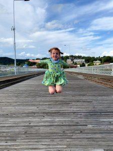 Six-year-old Emily Gooden jumps for joy on the Walnut Street Bridge while on staycation with her mom, Dr. Katie VonWerssowetz Gooden. (Photo: Katie Gooden)
