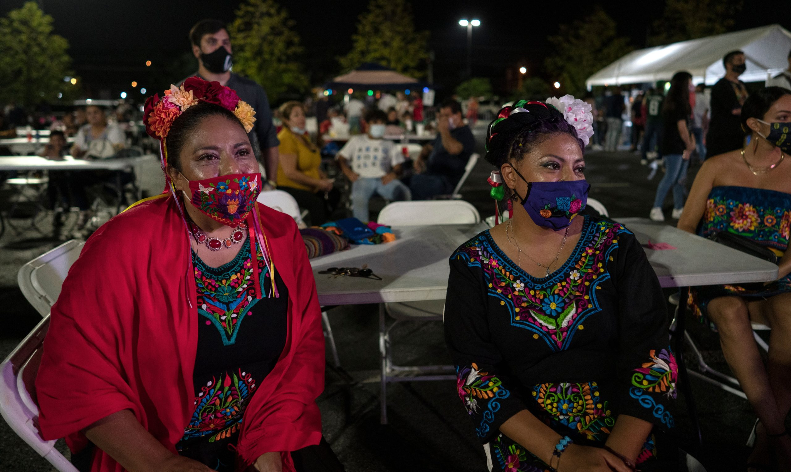 From left, Maria Lopez and Maria Rodriguez dress in traditional dress while attending Mexican independence day at Plaza Mariachi. (Photo: John Partipilo)