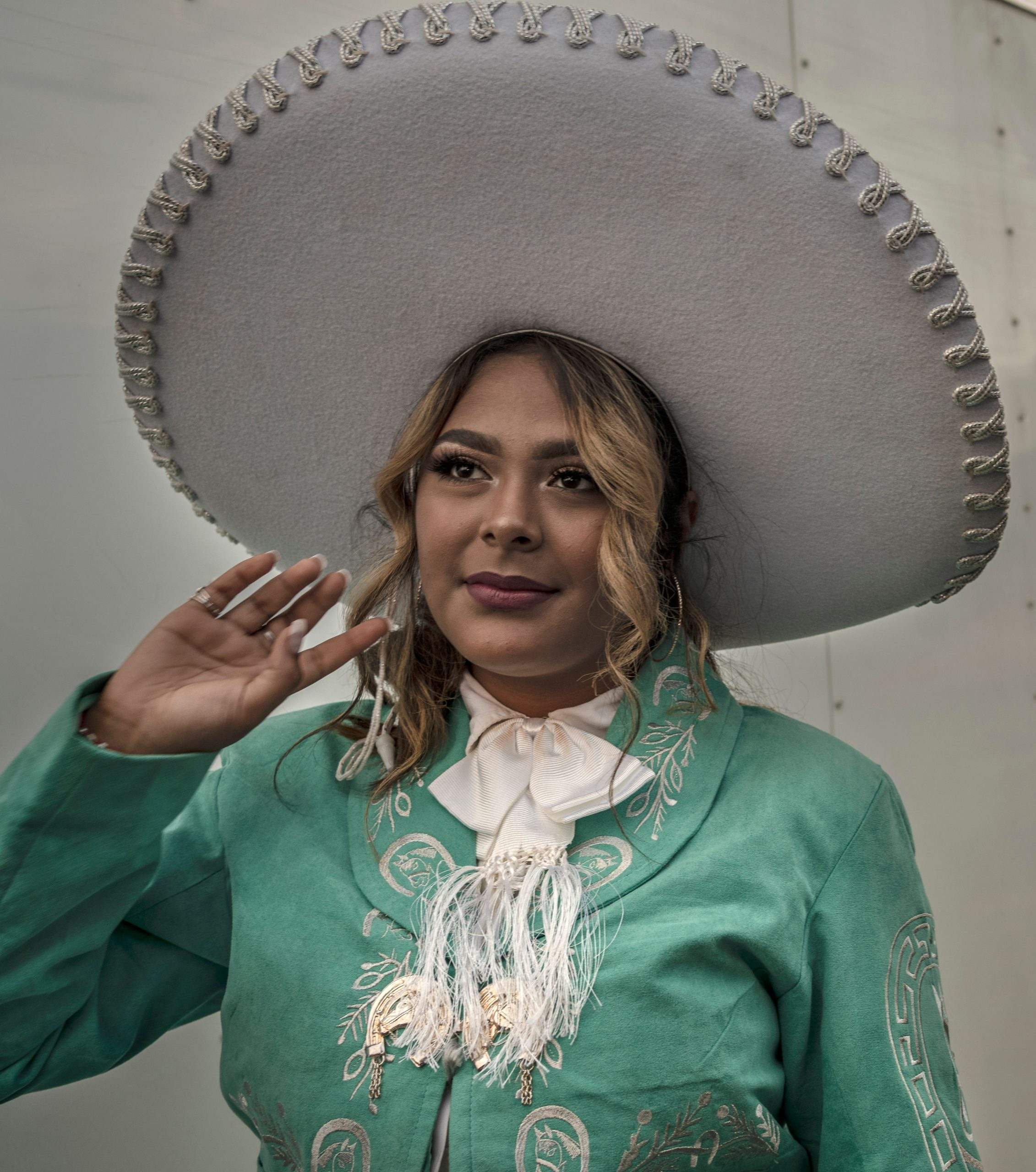Dressed in traditional clothing, singer Elena Jimenez gets ready to perform on the outdoor stage at Plaza Mariachi. (Photo: John Partipilo)