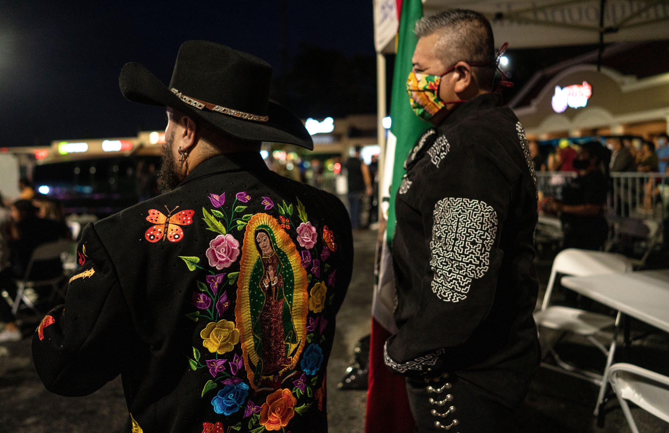 From left, Jose Vara dressed in a Manuel original coat and friend Aaron Rocha get ready to carry the Mexican flag on stage for the Mexican National Anthem during Mexican independence day at Plaza Mariachi. (Photo: John Partipilo)