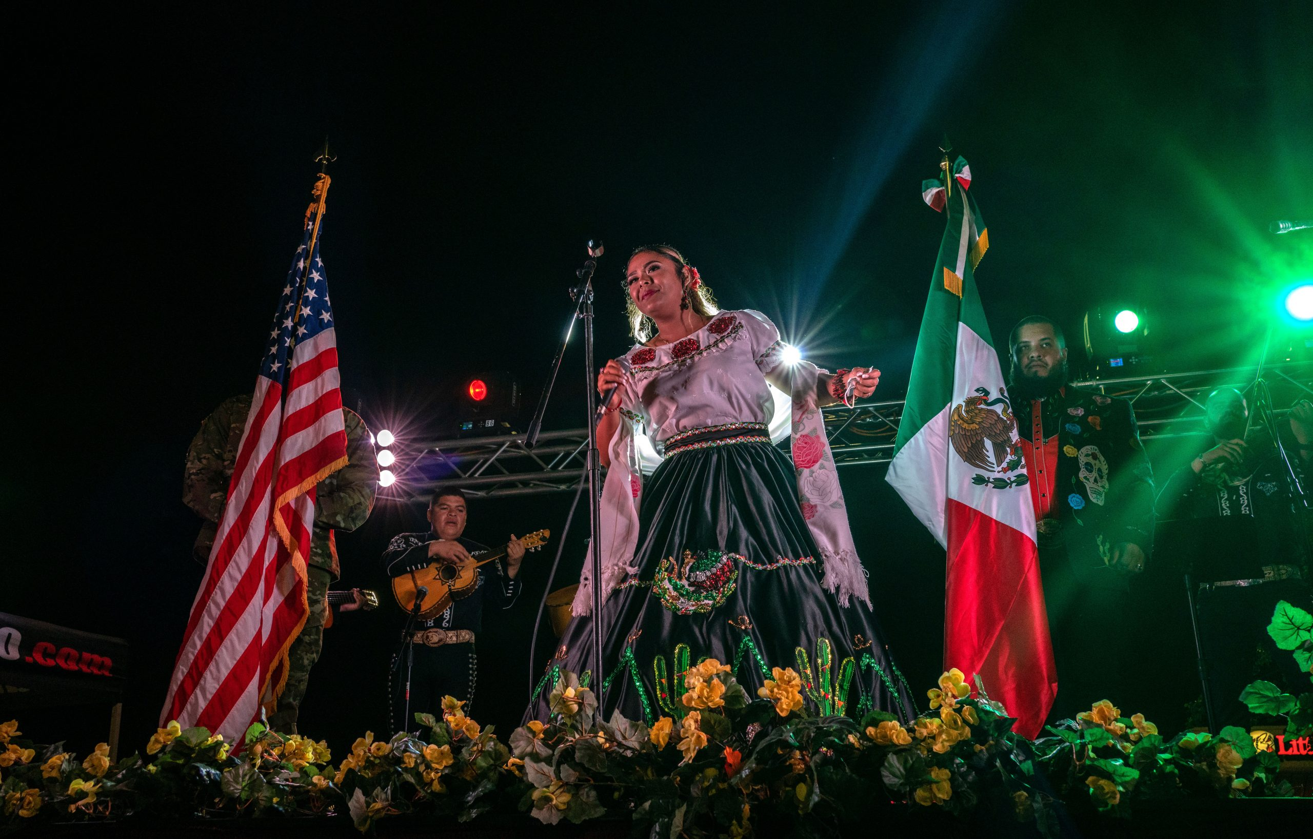 At the evening event, Elena Jimenez sings the Mexican National Anthem during a ceremony for Mexican independence day at Plaza Mariachi. (Photo: John Partipilo)