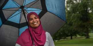 Let a smile be your umbrella. Nashville School Board Member Berthena Nabaa-McKinney. (Photo: John Partipilo)