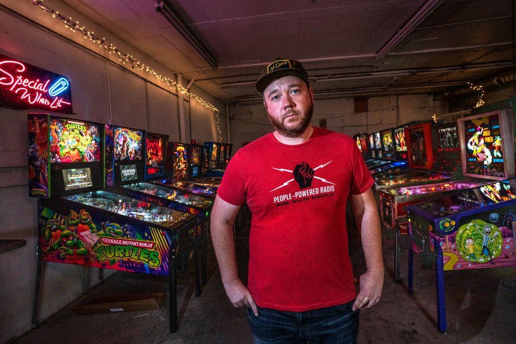 Seth Steele of A Smarter Nashville, inside his pinball machine warehouse (Photo: John Partipilo)