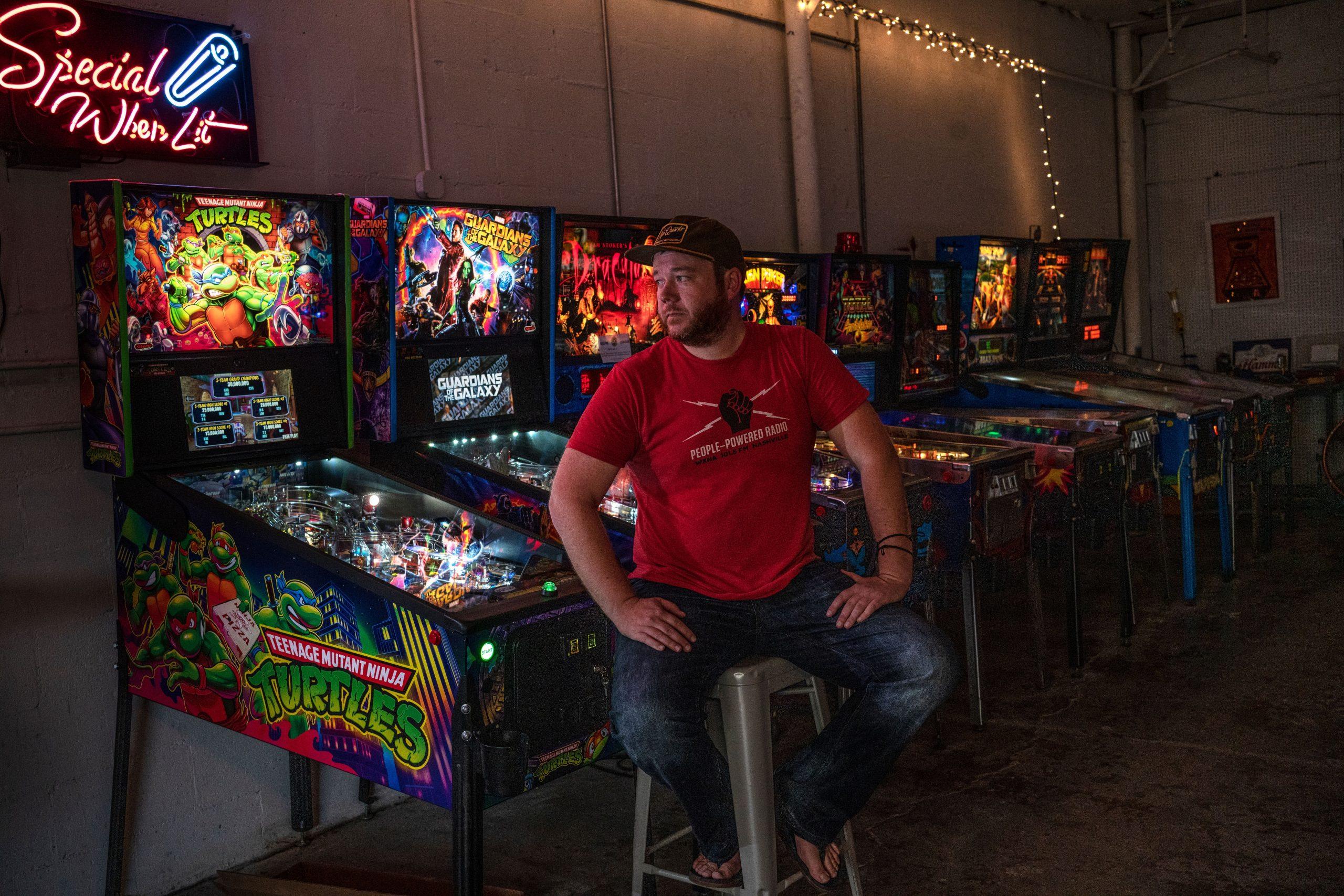 Seth Steele, bar owner and COVID-19 statistics watchdog, in his pinball machine warehouse. (Photo: John Partipilo)