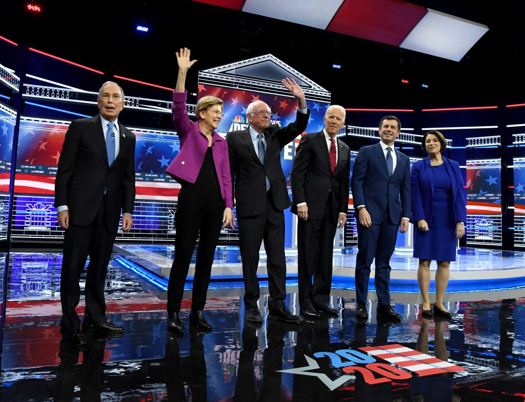 LAS VEGAS, NEVADA - FEBRUARY 19: Democratic presidential candidates (L-R) former New York City Mayor Mike Bloomberg, Sen. Elizabeth Warren (D-MA), Sen. Bernie Sanders (I-VT), former Vice President Joe Biden, former South Bend, Indiana Mayor Pete Buttigieg and Sen. Amy Klobuchar (D-MN) stand onstage at the start of the Democratic presidential primary debate at Paris Las Vegas on February 19, 2020 in Las Vegas, Nevada. Six candidates qualified for the third Democratic presidential primary debate of 2020, which comes just days before the Nevada caucuses on February 22. (Photo by Ethan Miller/Getty Images)
