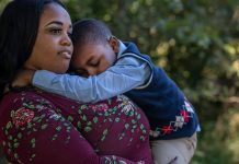 Elizabeth Jones holds her nephew, Isiah. She is his caretaker after his mother was killed in 2018 by her boyfriend in a murder-suicide. (Photo: John Partipilo)