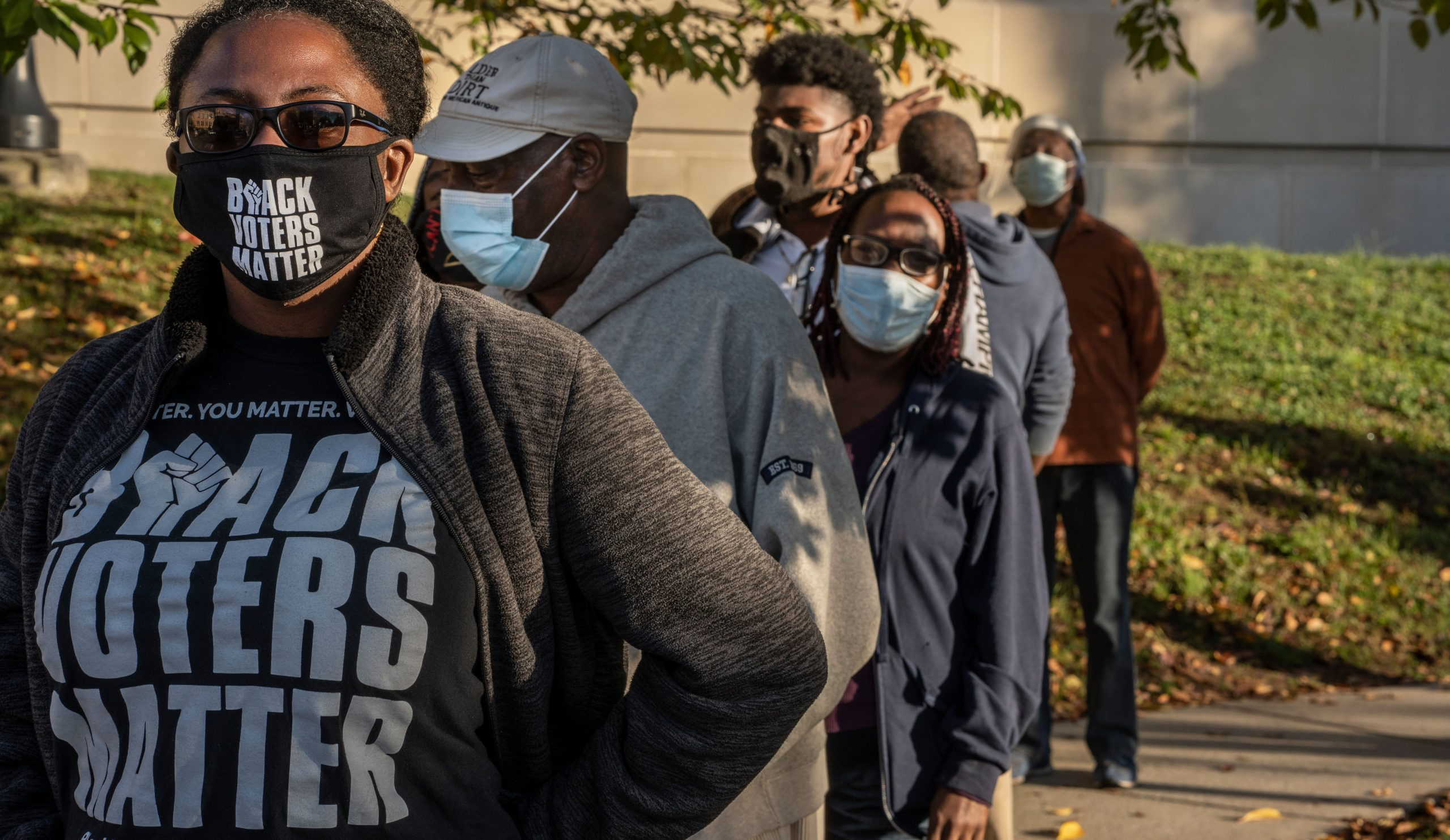 Early voter Lanna Williams, wearing a Black Lives Matter shirt, waits in line to vote with others at the Howard School in Nashville. Apparel with slogans not identified with a particular candidate or political party are permitted while voting. (Photo: John Partipilo)
