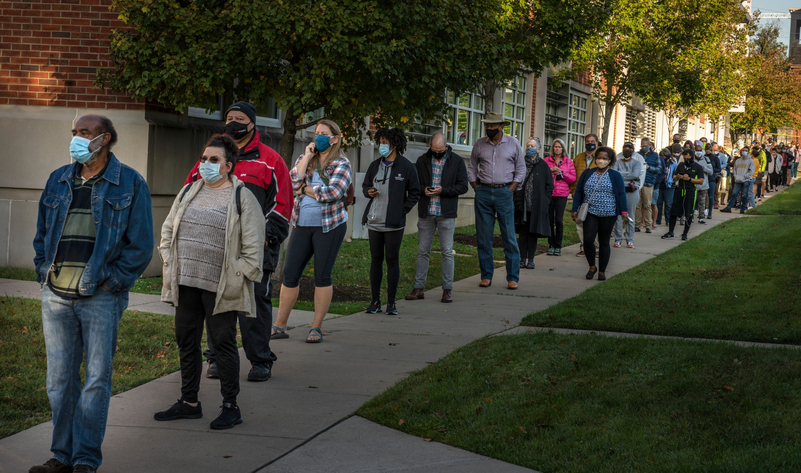 A large group of people wait in line to early vote at the Howard Building before Polls opened at 8:00am.(Photo: John Partipilo)