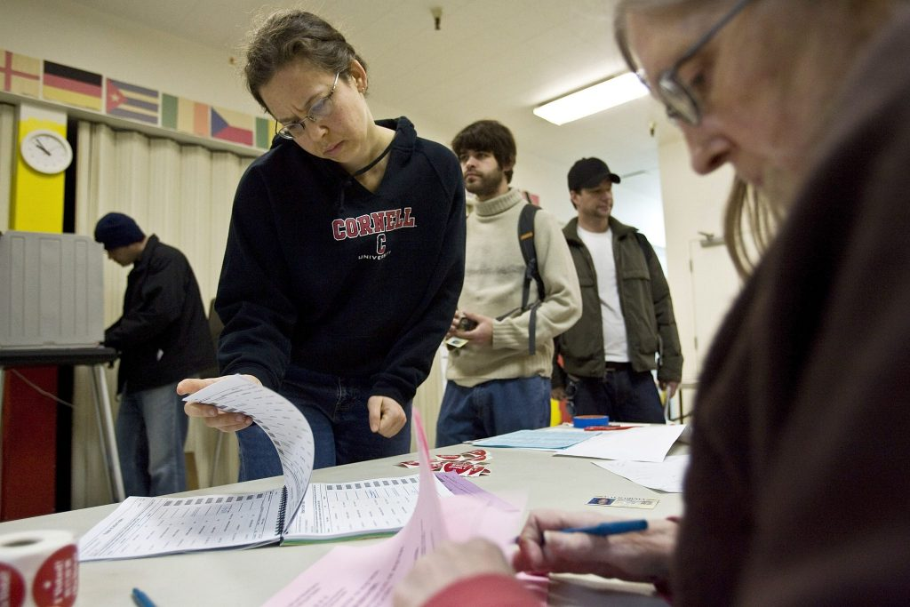 n this file photo Michelle Orengo-McFarlane looks for her name on a voter registration list in San Francisco, California. Some voters don't discover they've been purged from the voter rolls until they go to vote. (Photo by David Paul Morris/Getty Images)