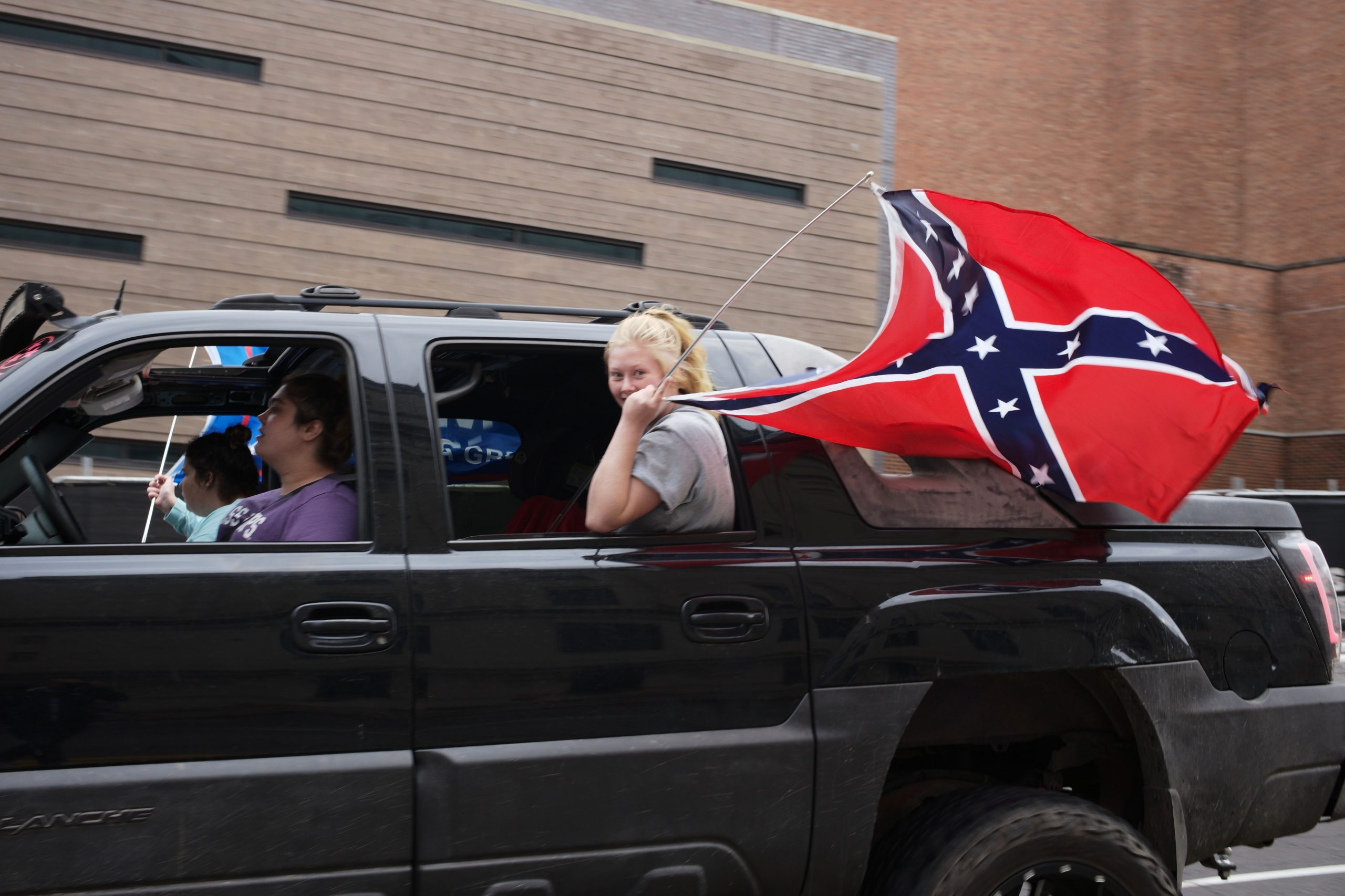 NASHVILLE, Tenn., Oct. 18- A young girl holds a Confederate battle flag during a Pro Trump parade down Lower Broadway where a long line of around 100 vehicles gathered for the Trucks for Trump rally, with Trump, American, Gadsden and Confederate flags attached, honking their horns in support. (Photo: Ray Di Pietro)